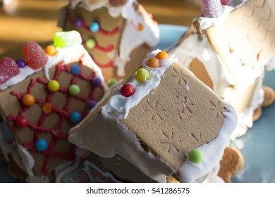 Close up of hand decorated mini gingerbread houses