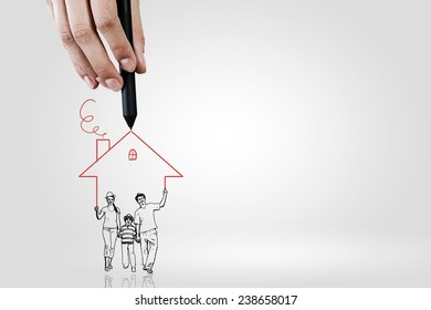 Close up of hand drawing sketches of happy family