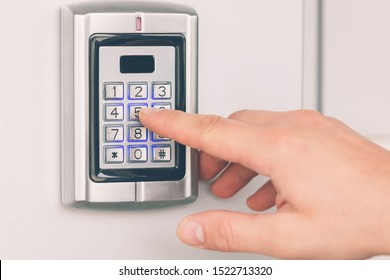 Close up of hand entering security system code