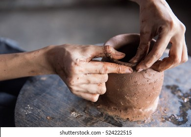close up of hand forming a clay in workshop