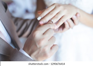 Close up hand groom couple put giving the Wedding Ring on bride. Propose for get marry marriage and love concept.
