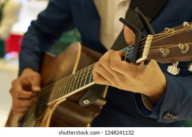 Close up Hand of Guitarist in Blue Jacket Playing Guitar on Stage with Band
