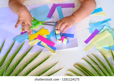 Close up hand Happy kids doing arts and crafts together at their desk. Child Make Paper Colorful Garland For Sukkah-Jewish Holiday.