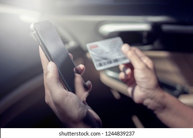 Close up hand have smartphone for shopping online by credit card in the car , freedom cocept payment