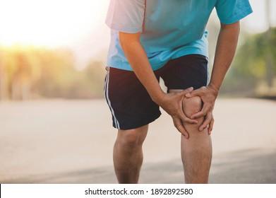 Close up hand hold knee, Senior Man are knee pain