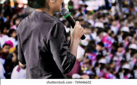 close up hand hold microphone master of ceremony annousment in event