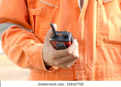 close up hand hold walkie talkie for outdoor