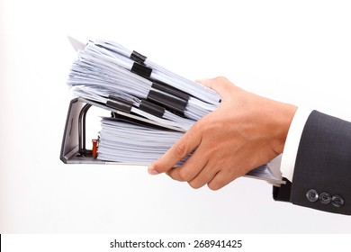 close up of hand holding binder on white background