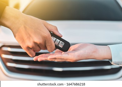 Close up hand holding Key sale car concept,Give and take key car