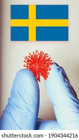 """close up of a hand holding the new """"Covid Variant"""" virus m Sweden"""