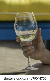 Close up of a hand holding wine glass