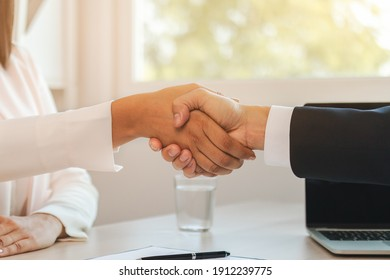 Close up hand of home, apartment agent or realtor handshake with newlandlord, tenant or rental. After the banker has approved and signed the purchase contract agreement successfully. Property concept.