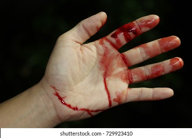 Close up hand injury, Finger cut with knife, real bloody hand
