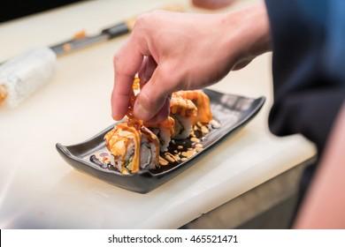 Close up hand of Japanese chef making sushi