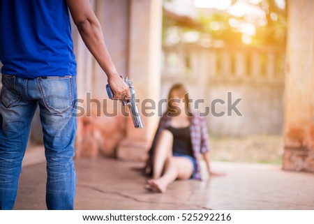 Close up Hand man holding gun with threaten woman