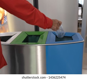 close up of  hand man throwing empty plastic bottle into the trash