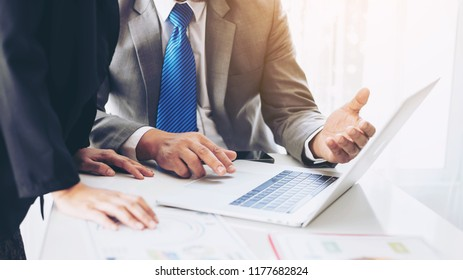close up hand of marketing manager employee pointing at business document on laptop computer during discussion at meeting room  - Business concept