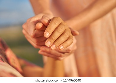 Close up hand massage on woman outdoor