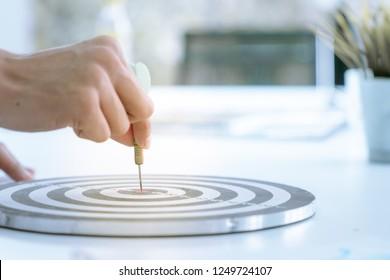Close up hand on dart arrow target like success concept business