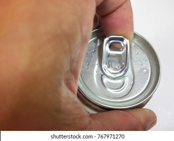 Close up a hand opening cover Aluminum canned drink