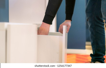 close up hand opens the shelf at home bedroom searching for things
