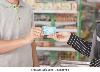 close up of a hand paying with credit card