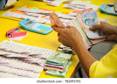close up of hand picking lottery tickets from street vendors concept for money ,fortune and gambling