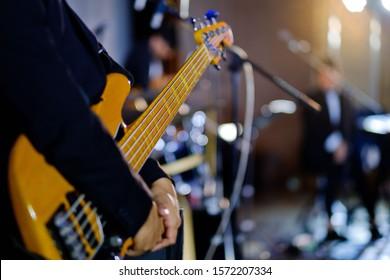 close up hand playing guitar, musical