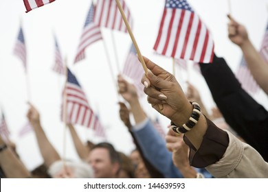 Close up of hand raising American flag
