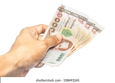 Close up Hand with Thai money isolated on white background, Business accounting.