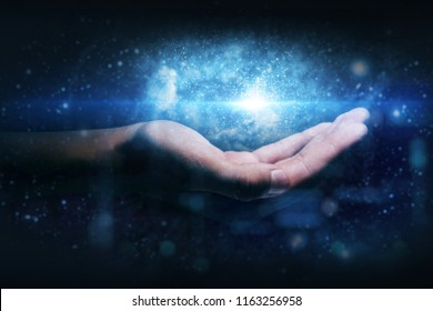 Close up of a hand that shows futuristic graphics in the holography of the world, the space and the universe both computer and internet. Concept of: future, connection, technology