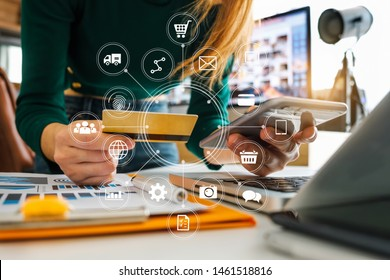 Close up of Hand using credit card and smartphone, laptop computer on wooden desk with VR icon chart graph diagram