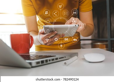 close up of hand using laptop, and holding tablet online banking payment communication network,internet wireless application development sync app,virtual graphic  icon diagram