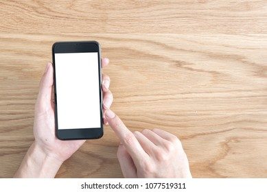 Close up hand using mobile smart phone white clipping path inside in screen on top view,  Empty background for create advertising.