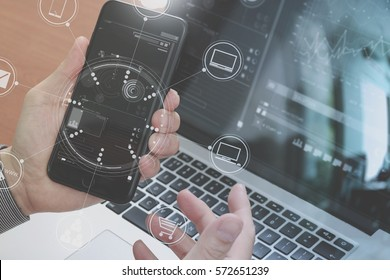 close up of hand using smart phone,laptop, online banking payment communication network technology 4.0,internet wireless application development sync app,virtual graphic icon diagram