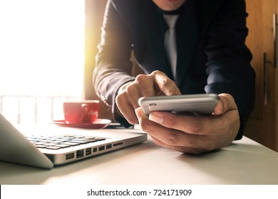 close up of hand using tablet ,laptop, and holding smartphone online banking payment communication network,internet wireless application development sync app,virtual graphic