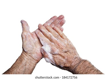 Close up of hand washing with soapy lather against a white background. Hand washing is recommended for killing germs, bacteria and viruses, some of which can cause H1N1 flu or swine flu.
