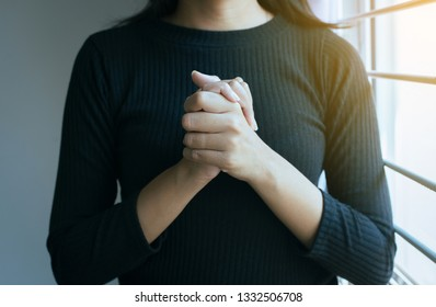 Close up of hand woman in praying position,Female pay respect or put your hands together in a prayer position