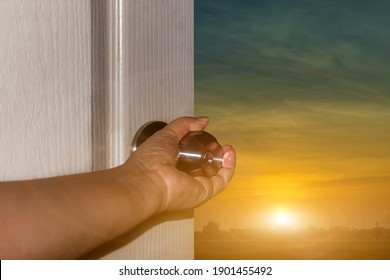 Close up hand of women open door knob or opening the door to nature view. Freedom concept
