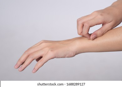 Close up hand of women scratch the itch with hand isolated on white background, Concept with healthcare and medicine.