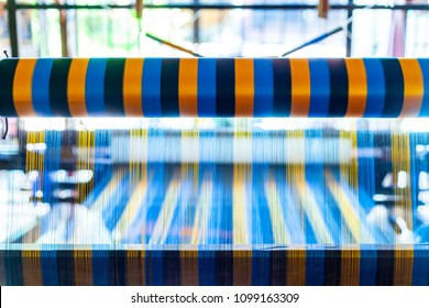 Close Up Hand Woven Cotton Weaver Machine Loom with Colorful Blue, Red, Yellow Silk Thread for made Fabric in Thailand