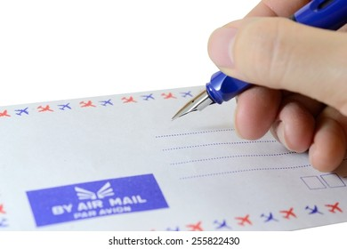 Close up of hand writing address on the letter