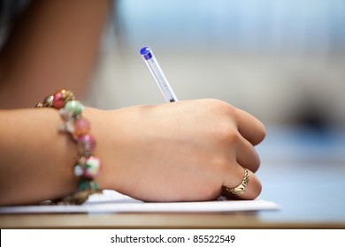 Close of a hand writing on a paper