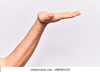 Close up of hand of young caucasian man over isolated background with flat palm presenting product, offer and giving gesture, blank copy space