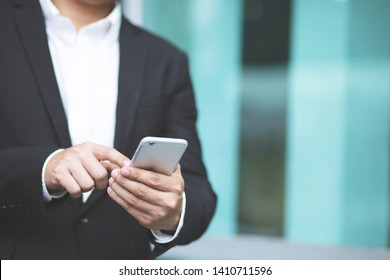 close up hand of young man using mobile smart phone. or Business man Contact Customer.