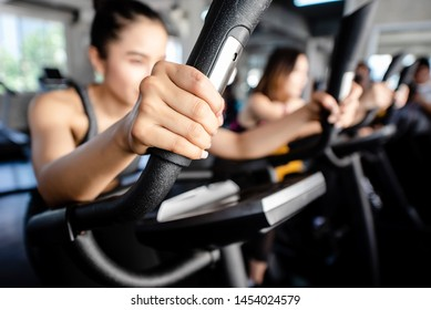 Close up hand of young woman bike cardio in the gym