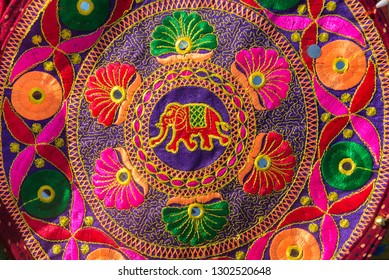 Close up of handcrafted piece of colorful Indian embroidery work. An elephant drawing with flower pattern in a fabric.
