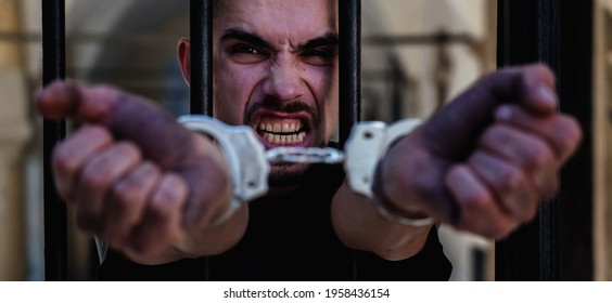Close up handcuffed man imprisoned for crime, punished for serious villainy. Arrest, gangster concept. Horizontal image.