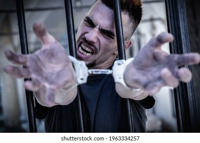 Close up handcuffed man imprisoned for crime, punished for serious villainy. Arrest, gangster concept.