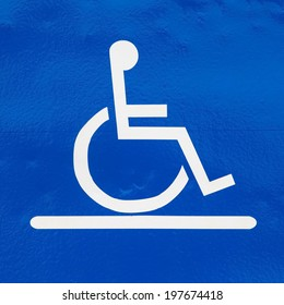 Close - up handicap sign reserved parking lot